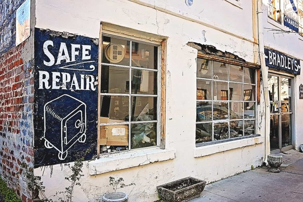 Crumbling old building with painted on signs or safe repairs plus lock and key work