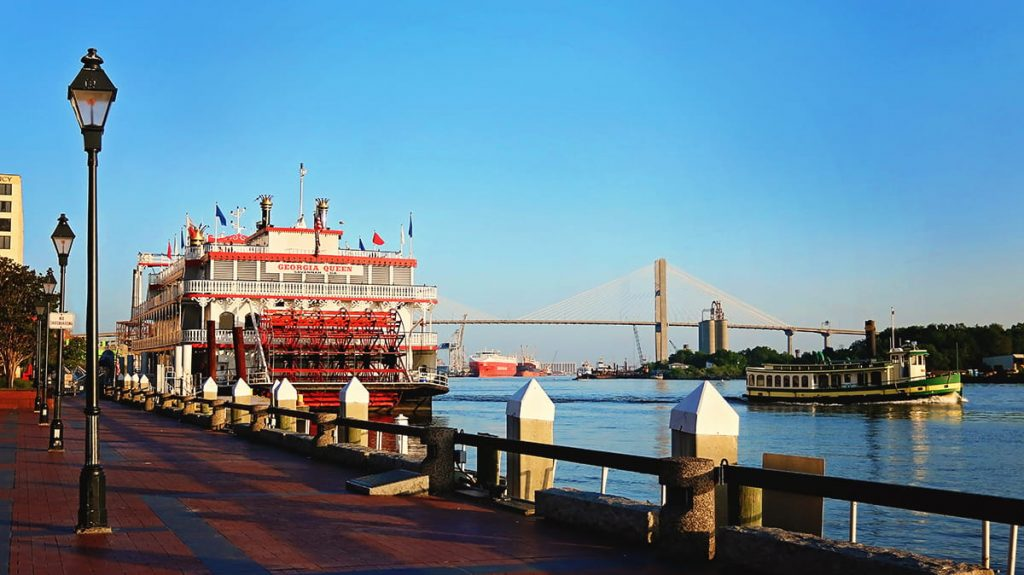 The Georgia Queen riverboat docked on River Street Savannah GA on a bright and sunny day