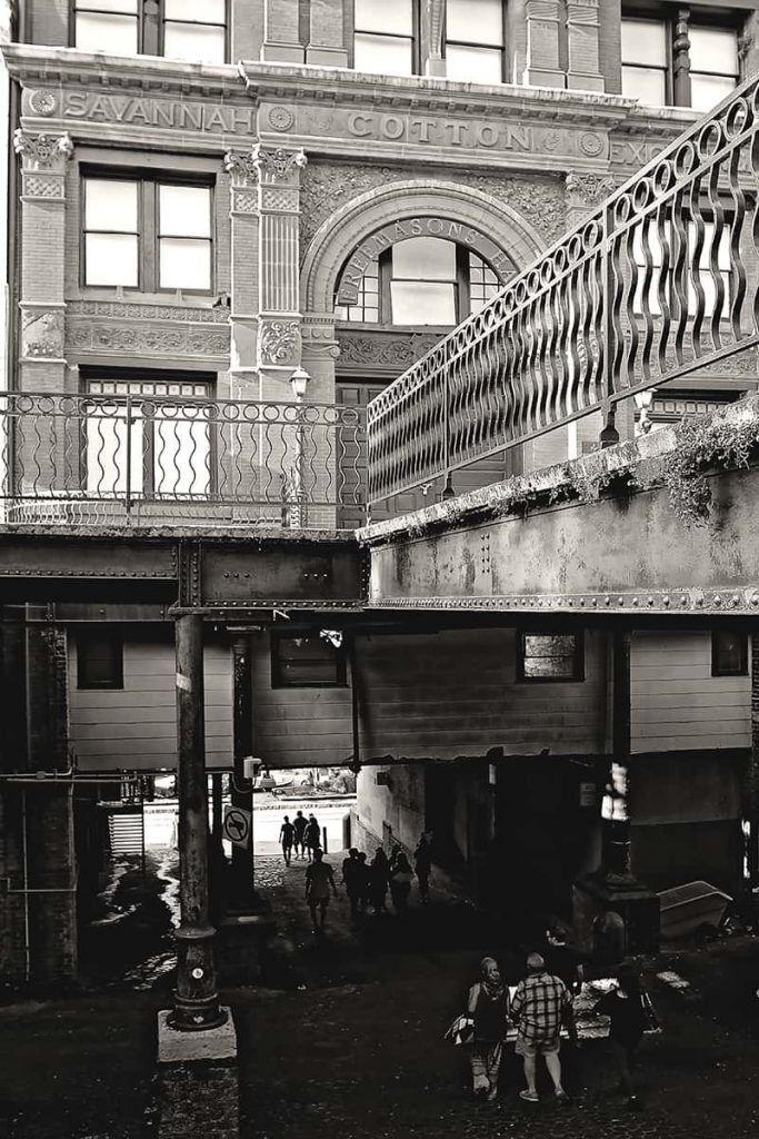 Old Cotton Exchange Building with a ramp and people walking beneath