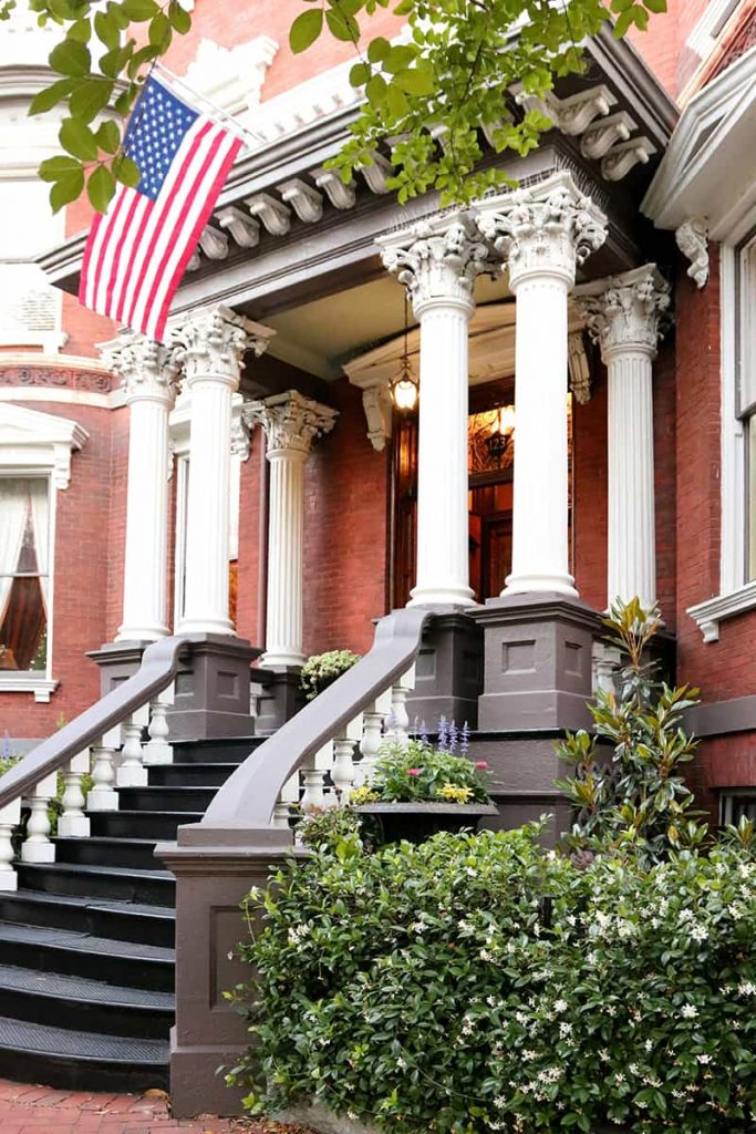 Elaborate front entrance to the Kehoe House with eight columns supporting the portico