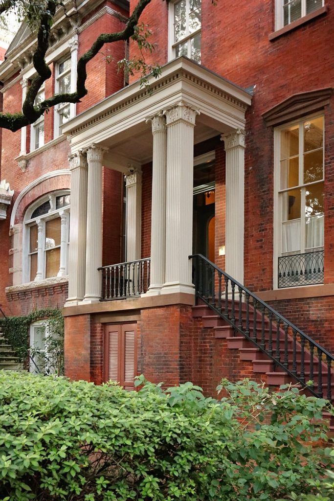 Stately columned front porch on a historic Jones Street home in Savannah