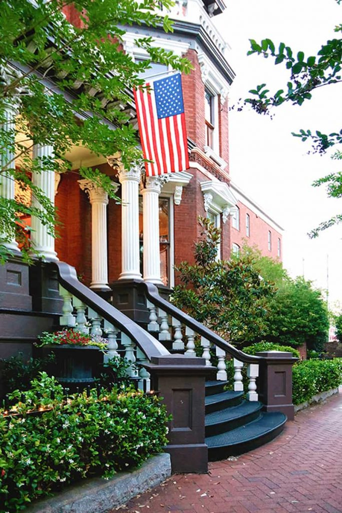 American flag hanging over the front entrance to the Kehoe House