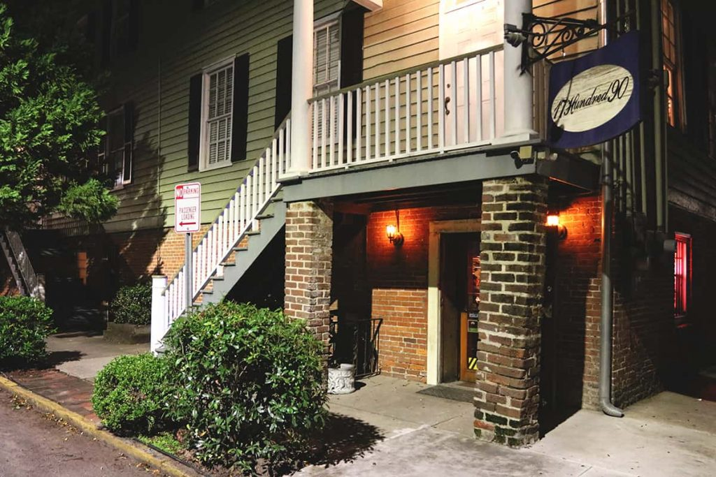 The entrance to the bar at 17Hundred90 Inn is hidden under the stairs at the corner of the building