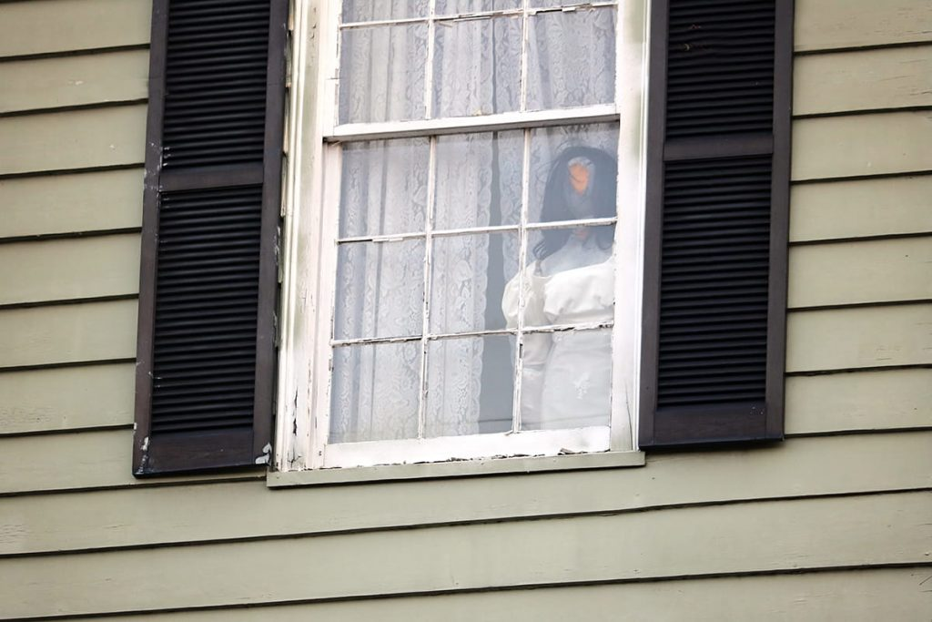 Mannequin of the ghost of Anna at the haunted 17Hundred90 Inn and Restaurant