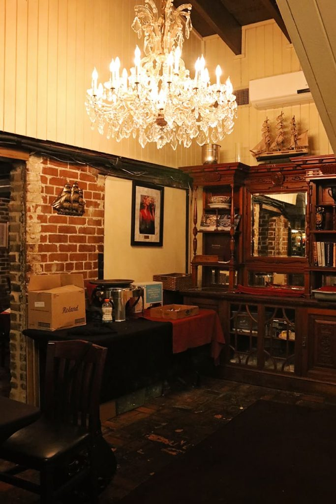 Office space with an antique desk and chandelier at the haunted 7Hundred90 Inn in Savannah