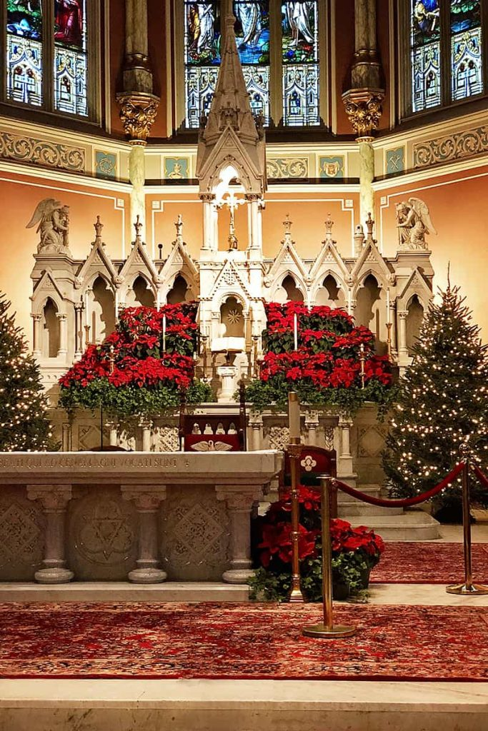 Interior of the Cathedral Basilica of St. John the Baptist withChristmas trees and poinsettias
