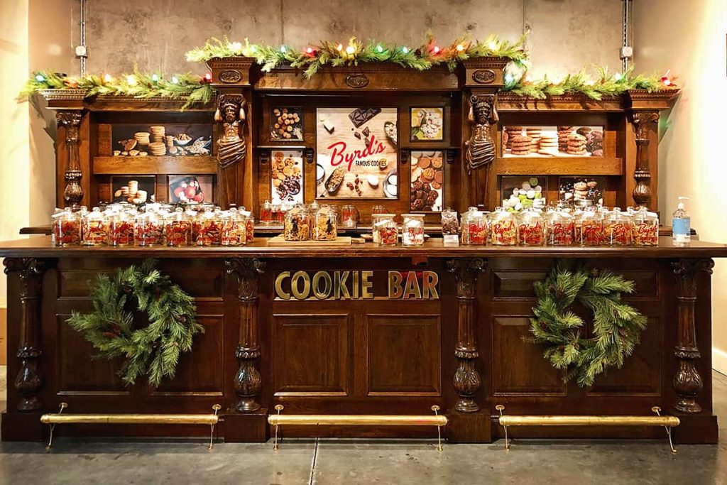 Christmas in Savannah at Byrd Cookie Company with a large wooden bar displaying various flavors of cookies