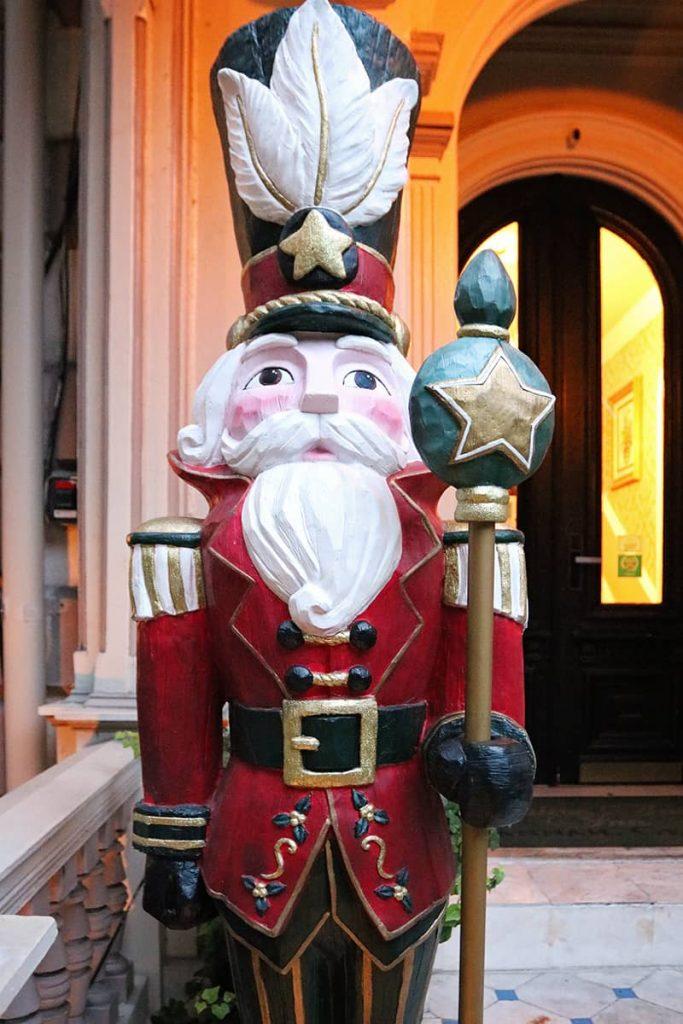 Close-up of an oversized nutcracker guarding the door of the Hamilton-Turner Inn in Savannah