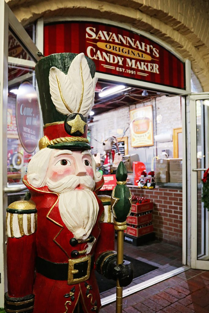 Close-up of a nutcracker guarding the entrance to Savannah Candy Kitchen