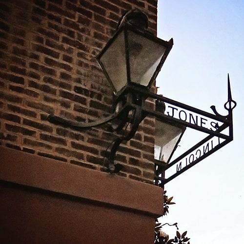 Silhouette of a metal street sign on Jones Street in Savannah Georgia.