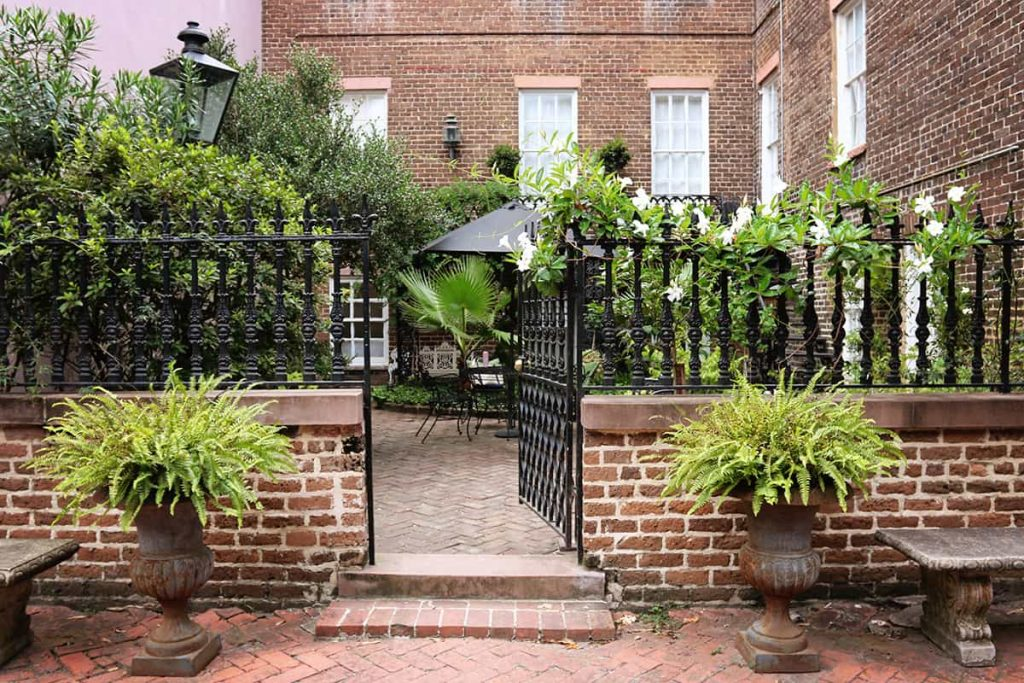 An open gate leading to a private garden on Jones Street