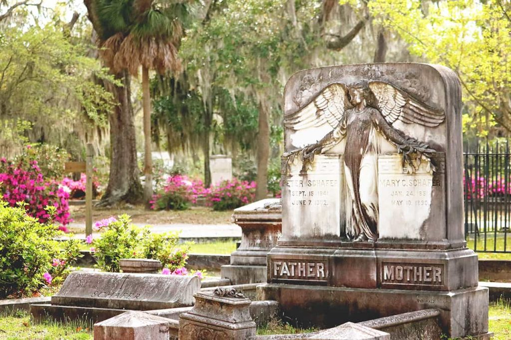 Dual mother/father headstone with an angel guarding both sides