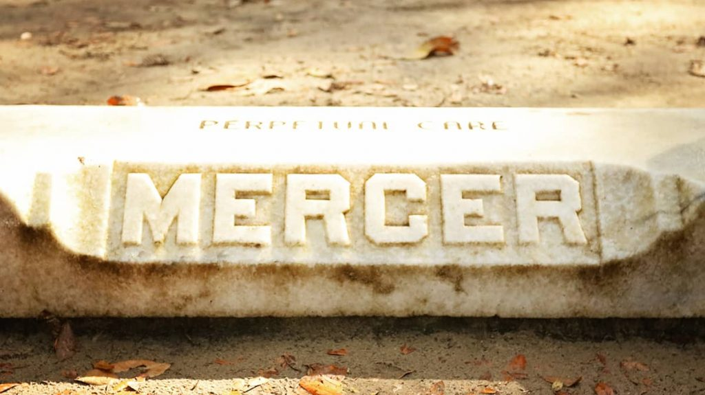 "Entrance to the Mercer Family Plot in Bonaventure Cemetery with ""MERCER"" and ""perpetual care"" carved in stone"