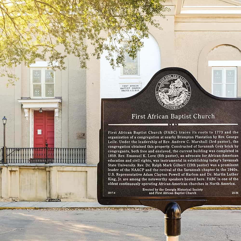 Historic Marker for First African Baptist Church with the church's red front door showing in the background