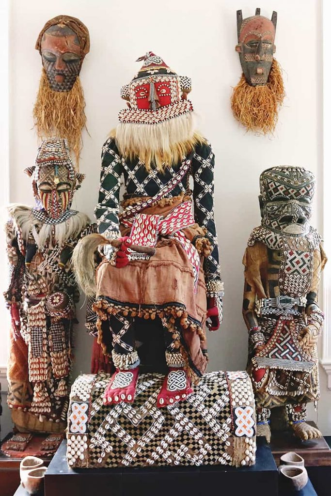 Statues with elaborate beadwork and detailed clothing and facial features at the Savannah African Art Museum