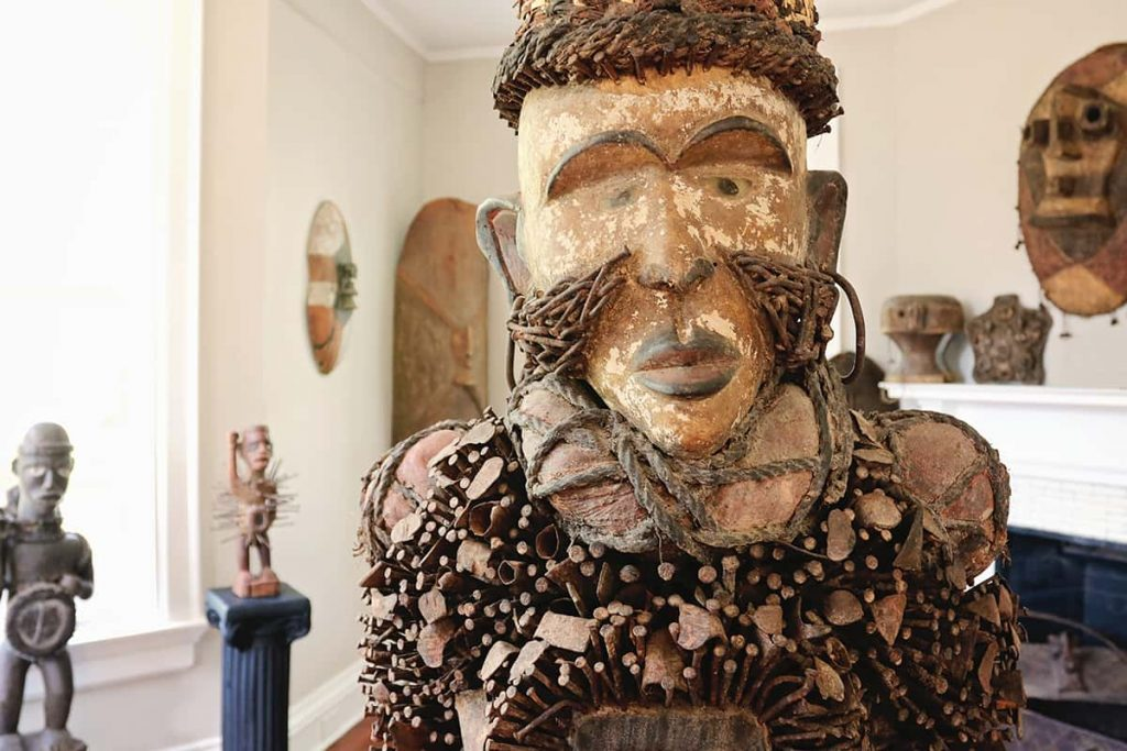 Statue of a man with nails sticking out of his chest and forming his facial hair and the hair atop his head