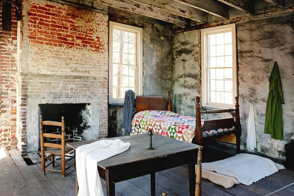 Sparsely decorated slave quarters at the Owens-Thomas House