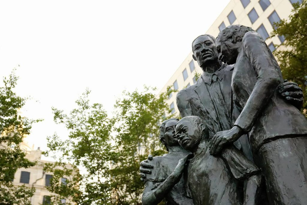 Close up of steadfast faces of the family carved into the African American Monument in Savannah