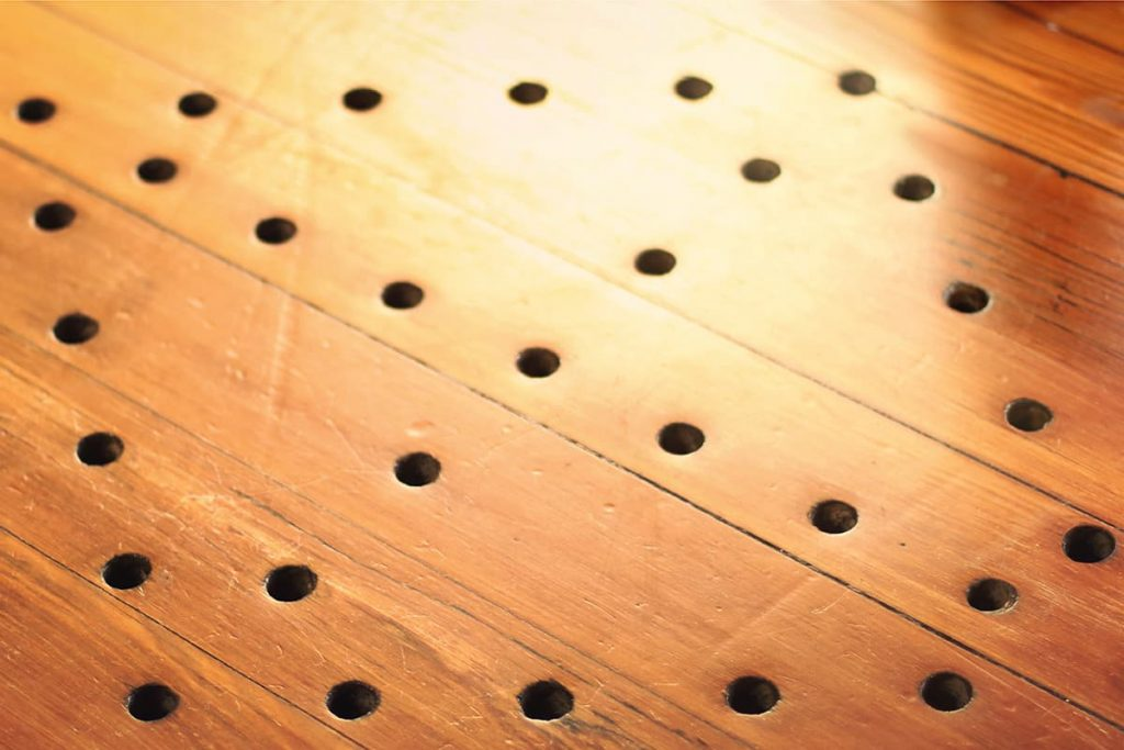 Holes punched into the floorboards form shape of a Congolese Cosmogram at First African Baptist Church in Savannah