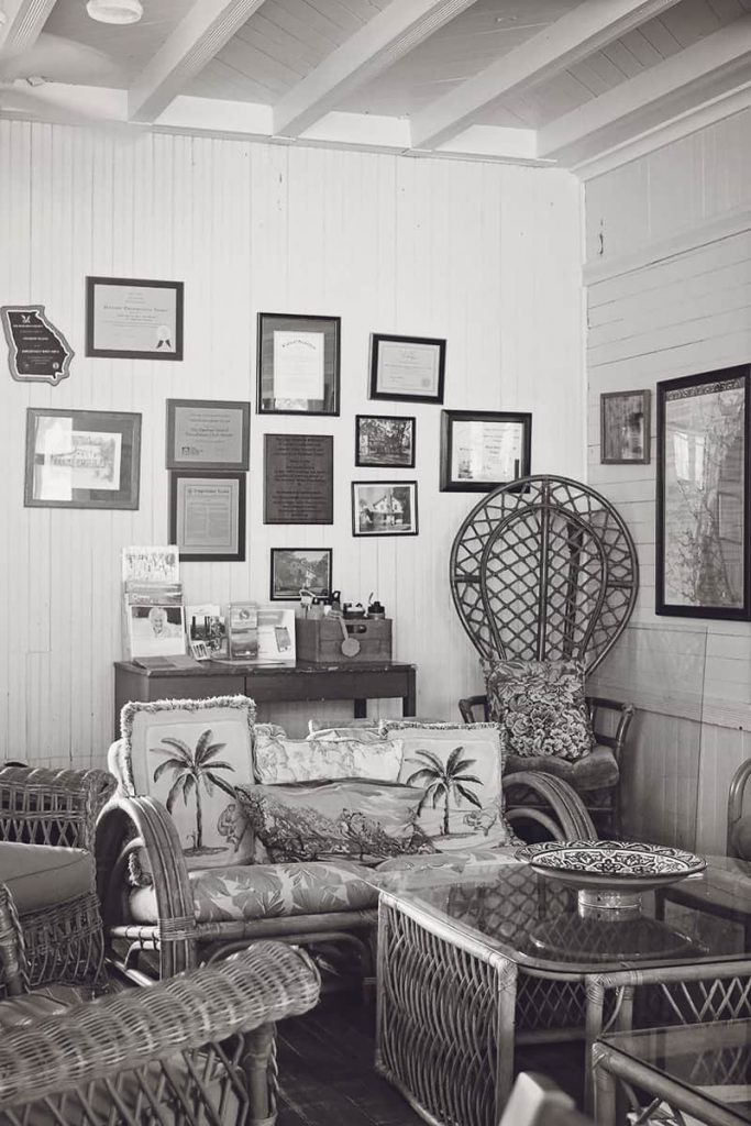 A room in the Club House on Ossabaw with photos and memorabilia on the shiplap walls