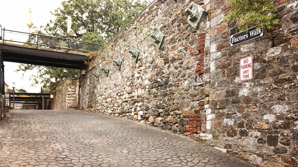 An old wall on Factors Walk constructed from a variety of stones and bricks