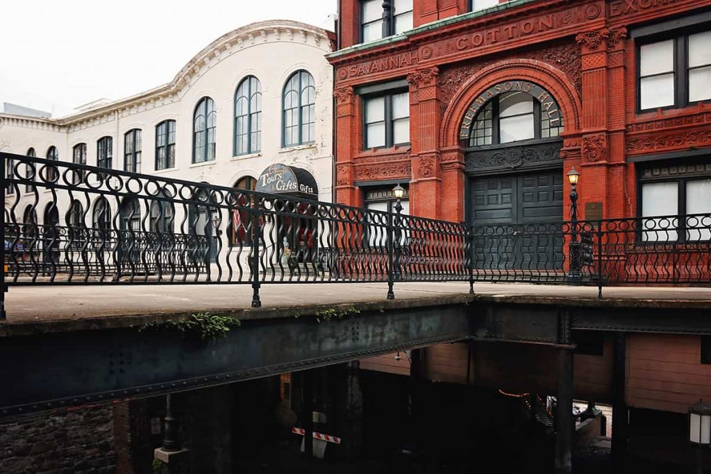 The Savannah Cotton Exchange building with an elaborate terra cotta facade sits atop a concrete and steel framed bridge that's open underneath