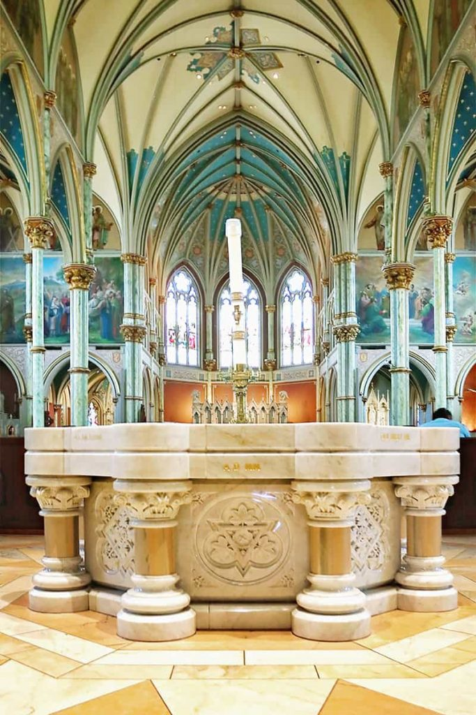 Intricate marble baptismal font at the Cathedral Basilica of St. John the Baptist in Savannah's Historic District