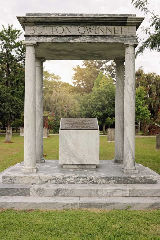 Elaborate four-column grave marker for Button Gwinnett in Colonial Park Cemetery