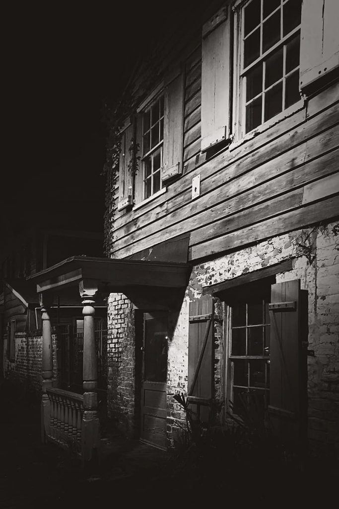 Spooky B&W night image of the Pirates' House, one of the most haunted restaurants in Savannah